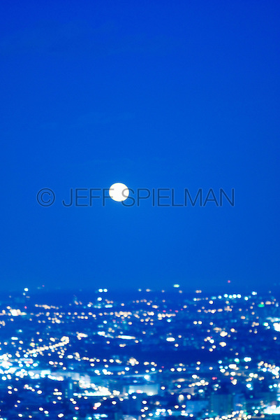 Soft Focus New York Cityscape with Full Moon at Night<br /> <br /> Queens Skyline viewed from Midtown Manhattan, New York City, New York State, USA