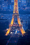 A clolsed up twilight light aerial view of Eiffel Tower with area of Right Bank and La Défense in the background. City of Paris. Paris. France