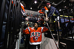 Cameron Burt of RIT slaps hands with fans before the first period. RIT lost to Air Force 0-4. at Blue Cross Arena in Rochester, New York on March 17, 2012.