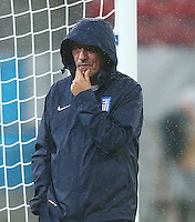 Greece coach Fernando Santos looks thoughtful with his hood up during the training session ahead of tomorrow's fixture vs Costa Rica