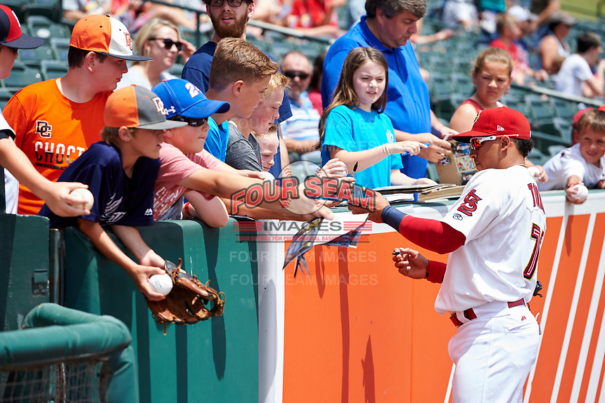 Memphis Redbirds Wilfredo Tovar (71) signs autographs for fans before a game against the Iowa Cubs on May 29, 2017 at AutoZone Park in Memphis, Tennessee.  Memphis defeated Iowa 6-5.  (Mike Janes/Four Seam Images)