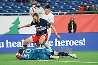 FOXBOROUGH, MA - MAY 1: Matt Turner #30 of New England Revolution dives to save a shot as Franco Ibarra #14 Midfielder of Atlanta United FC attacks during a game between Atlanta United FC and New England Revolution at Gillette Stadium on May 1, 2021 in Foxborough, Massachusetts.