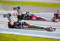 Aug 9, 2020; Clermont, Indiana, USA; NHRA top fuel driver Terry McMillen (near) defeats Doug Kalitta during the Indy Nationals at Lucas Oil Raceway. Mandatory Credit: Mark J. Rebilas-USA TODAY Sports