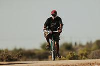 A man on a bicycle covers himself with the summer sun with a cap and bandana as he passes through the La Cruz estuary in Kino viejo, Sonora, Mexico.<br /> (Photo: Luis Gutierrez / NortePhoto.com).<br /> Un hombre en bicicleta se cubre de sol de verano con una gorra y paliacate en su paso por el estero La Cruz en  Kino viejo, Sonora, Mexico. <br /> (Photo: Luis Gutierrez / NortePhoto.com).