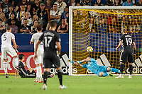 CARSON, CA - SEPTEMBER 15: David Bingham #1 of the Los Angeles Galaxy dives for a ball during a game between Sporting Kansas City and Los Angeles Galaxy at Dignity Health Sports Complex on September 15, 2019 in Carson, California.