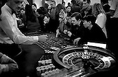 Moscow, Russia .1995.A business man cowers to the camera in a Moscow casino. Keeping a low profile is important for survivial, as a high social profile can easily get you killed in Russia.