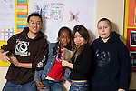 High school students posing in corridor