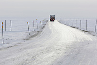 Semi tractor trailer travels the James Dalton Highway near Prudhoe Bay, Arctic North Slope, Alaska.