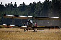 De Havilland DH-82A Tiger Moth II Coming having laned in a field. <br /> <br />  Airplanes and reenactors photographed at in connection with Høytorptreffet, an annual event at the Høytorp fort. <br /> <br /> Høytorp fort is a barrage fort in the Glomma defence line, built 1912-17. On April 13th and 14th 1940 the fort was in combat against German army units . It is now protected as a national monument.<br /> <br /> ©Fredrik Naumann/Felix Features