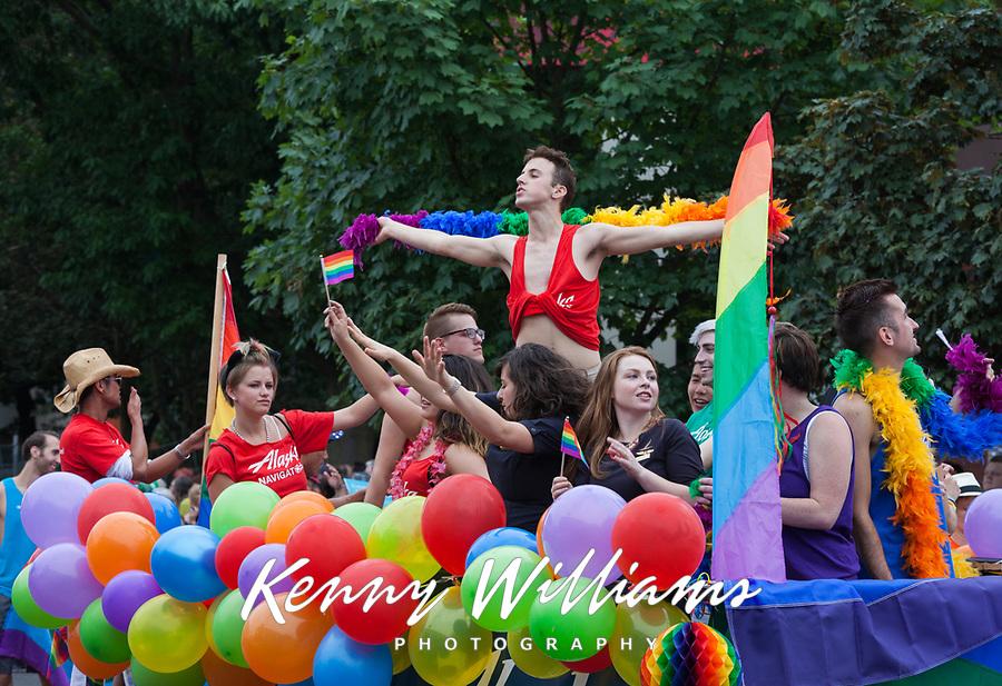 Group Dancing on Rainbow Balloon Parade Float, Seattle PrideFest 2015, Washington State, WA, America, USA.