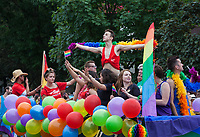 Group Dancing on Rainbow Balloon Parade Float, Seattle PrideFest 2015, Washington State, WA, America, USA.