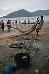 Fishermen pulling in their nets on the beach at Balneario Camboriu, Santa Catarina, Brazil