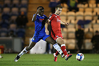Jake Hessenthaler of Crawley Town and Kwame Poku of Colchester United during Colchester United vs Crawley Town, Sky Bet EFL League 2 Football at the JobServe Community Stadium on 1st December 2020