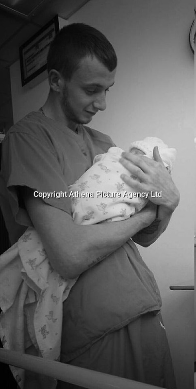 UPDATED CAPTION<br /> Pictured: Shaun Harvey holding one of his children after they were born, one of his two sons died in a caravan fire, while he was injured in Ffair Rhos, Ceredigion, Wales, UK.<br /> Re: Three-year-old Zach Harvey was killed in a caravan fire in the early hours of Sunday morning at Ffair Rhos, near Tregaron, Ceredigion, west Wales.<br /> His father Shaun Harvey and his four year old brother Harley is in a critical but stable condition in hospital and his dad's condition is stable.<br /> The fire service said a touring caravan and vehicle were completely destroyed and adjacent property damaged in the blaze.<br /> Emergency services had been called to the scene at 5.35am on Sunday.