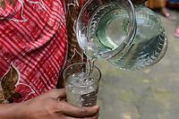 BANGLADESH, District Tangail, Kalihati, village Southpara, drinking water / Trinkwasser im Glas