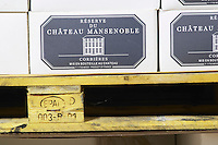 Wine case carton. Chateau Mansenoble. In Moux. Les Corbieres. Languedoc. Barrel cellar. France. Europe.