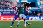 Sergio Leon of Osasuna (R) fights for the ball with Diego Roberto Godin Leal of Atletico de Madrid (L) during the La Liga match between Atletico de Madrid vs Osasuna at Estadio Vicente Calderon on 15 April 2017 in Madrid, Spain. Photo by Diego Gonzalez Souto / Power Sport Images