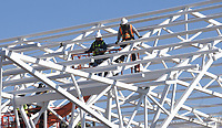 Workers make progress Tuesday Jan. 12 2021 on a canopy over a performance stage at Rail Yark Park in downtown Rogers. Go to nwaonline.com/210113Daily/ to see more photos.<br />(NWA Democrat-Gazette/Flip Putthoff)