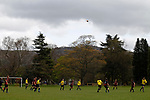 Keswick 1 Kendal 1, 15/04/2017. Fitz Park, Westmoreland League. The players wait for a high ball to drop. Photo by Paul Thompson.