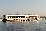 A cruise ship on the River Nile at Luxor.The town of Luxor occupies the eastern part of a great city of antiquity which the ancient Egytians called Waset and the Greeks named Thebes.