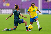 ORLANDO, FL - FEBRUARY 18: Marina Delgado #4 of Argentina tries to tackle Marta #10 of Brazil during a game between Argentina and Brazil at Exploria Stadium on February 18, 2021 in Orlando, Florida.
