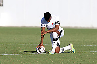 RICHMOND, VA - SEPTEMBER 30: Dre Fortune #8 of North Carolina FC takes a knee during the playing of the national anthem before a game between North Carolina FC and New York Red Bulls II at City Stadium on September 30, 2020 in Richmond, Virginia.