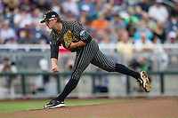 Vanderbilt Commodores pitcher Carson Fulmer (15) follows through on a pitch to the plate during the NCAA College baseball World Series against the Cal State Fullerton Titans on June 14, 2015 at TD Ameritrade Park in Omaha, Nebraska. The Titans were leading 3-0 in the bottom of the sixth inning when the game was suspended by rain. (Andrew Woolley/Four Seam Images)