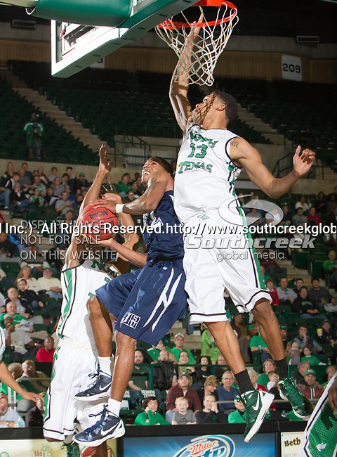 Jackson State Tigers guard Kelsey Howard (12) and North Texas Mean Green forward Tony Mitchell (13) in action during the game between the Jackson State Tigers and the University of North Texas Mean Green at the North Texas Coliseum,the Super Pit, in Denton, Texas. UNT defeated Jackson State 69 to 55...