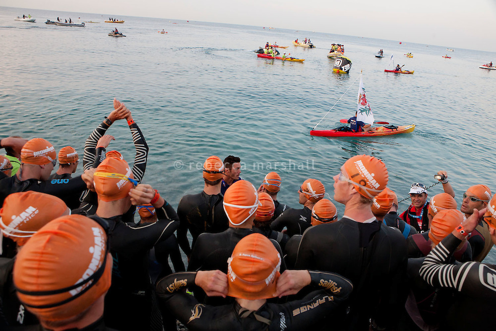 Professional triathletes prepare start the 2012 Ironman at 6.25 am with a 3.8 km swim in the sea, Nice, France, 24 June 2012