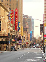 New York, New York City. New Yorkers are told to stay home during the corona virus, (COVID-19) so New York has become eerily empty. The Theatre District is devoid of people and its audience.