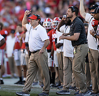 ATHENS, GA - OCTOBER 16: Kirby Smart signals to hos team during a game between Kentucky Wildcats and Georgia Bulldogs at Sanford Stadium on October 16, 2021 in Athens, Georgia.