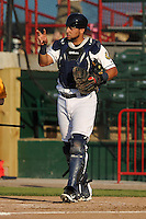 Burlington Bees Webster Rivas (14) gives out signals during the Midwest League game against the Peoria Chiefs at Community Field on June 9, 2016 in Burlington, Iowa.  Peoria won 6-4.  (Dennis Hubbard/Four Seam Images)