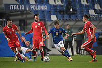 Nicolo Barella of Italy and Grzegorz Krychowiak, Jan Bednarek and Jakub Moder of Polandduring the Uefa Nation League Group Stage A1 football match between Italy and Poland at Citta del Tricolore Stadium in Reggio Emilia (Italy), November, 15, 2020. Photo Andrea Staccioli / Insidefoto