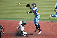Carter Trice (4) of the Old Dominion Monarchs jumps for a high throw as Craig Keuchel (9) of the Charlotte 49ers slides into second base at Hayes Stadium on April 25, 2021 in Charlotte, North Carolina. (Brian Westerholt/Four Seam Images)