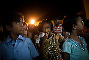 Orphans whose parents were the victims of the Naxalite insurgency gather for the evening prayers at their orphanage in Dantewada in Chhattisgarh, India. Photo: Sanjit Das/Panos for The Times