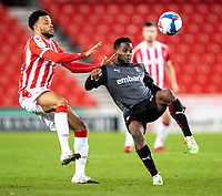 31st October 2020; Bet365 Stadium, Stoke, Staffordshire, England; English Football League Championship Football, Stoke City versus Rotherham United; Florian Jozefzoon of Rotherham United under pressure from Jordan Cousins of Stoke City