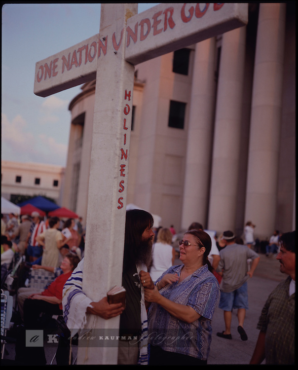 August 26-30, 2003-- Montgomery, Alabama. On the steps of the State Supreme Court people protest the possible removal of the Ten Commandments from the Rotunda. The 3 ton statue was put there by the Chief Justice of the Court Judege  Roy Moore.