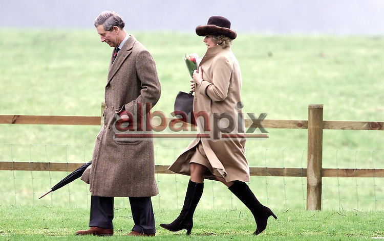 Alban Donohoe Picture Service-Picture by Alban Donohoe.Prince Charles and Camilla Parker-Bowles attend Sandringham Church after spending the Weekend at Sandringham House with guest. Camila runs to keep up with  Prince Charles 17/3/02.