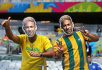 Brazil supporters wear face masks of their injured striker Neymar