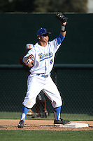 Brett Urabe (44) of the UCLA Bruins takes a throw at first base during a game against the Texas Longhorns at Jackie Robinson Stadium on March 12, 2016 in Los Angeles, California. UCLA defeated Texas, 5-4. (Larry Goren/Four Seam Images)