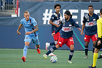 FOXBOROUGH, MA - SEPTEMBER 19: Lee Nguyen #42 of New England Revolution passes the ball as Gudmundur Thorarinsson #20 of New York City FC closes in during a game between New York City FC and New England Revolution at Gillette on September 19, 2020 in Foxborough, Massachusetts.