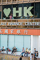 Hong Kong, Government Offices, 1 October 2014<br /> <br /> Students and other supporters of the Occupy Central movement congregating around the government offices area at Tamar. All the roads in the area are blocked from traffic and public transport.<br /> Some businesses support the movement like this finance centre.<br /> <br /> Photo Kees Metselaar