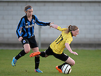 20140502 - VARSENARE , BELGIUM : duel pictured between Brugge's Ellen Lagrange (l) and Lierse's Silke Leynen (r) during the soccer match between the women teams of Club Brugge Vrouwen  and WD Lierse SK  , on the 26th matchday of the BeNeleague competition on Friday 2 May 2014 in Varsenare .  PHOTO DAVID CATRY
