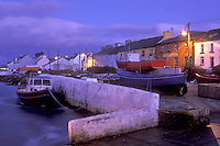 AJ0988, Europe, Republic of Ireland, Ireland, Ring of Kerry, Portmagee, fishing boats docked at harbor in the evening in County Kerry.