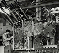 Somewhere in Quebec they're turning out these Chicago pianos Canadian warships and from the Canadian army that has waited ne More and more; Quebec women are on the job in this gun plant.<br /> <br /> PHOTO :    - Toronto Star Archives - AQP