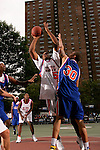 Samardo Samuels (50) is defended by Michael Beasley (30) during the Elite 24 Hoops Classic game on September 1, 2006 held at Rucker Park in New York, New York.  The game brought together the top 24 high school basketball players in the country regardless of class or sneaker affiliation.