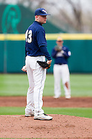 Lars Liguori (43) of the Oral Roberts Golden Eagles reads the pitching sign during a game against the Missouri State Bears on March 27, 2011 at Hammons Field in Springfield, Missouri.  Photo By David Welker/Four Seam Images