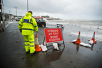 "Pictured: A police officer makes sure that the seaside road is closed off because of waves that crash against the seaside town of Aberystwyth, Wales, UK. Saturday 21 October 2017<br /> Re: Coastal parts of the UK is facing winds of up to 70mph as Storm Brian causes roads to close and public transport to be cancelled.<br /> Roads in Aberystwyth's seafront and at nearby Aberaeron, Wales are shut on Saturday morning as a yellow ""be aware"" Met Office warning is in place.<br /> Seven flood warnings have been issued for the west Wales coast."