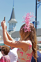 30th April 2021; Kentucky, USA;  A spectator takes a selfie of her hat during Oaks Day on April 30, 2021 at Churchill Downs in Louisville, Kentucky.