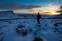 04/02/15<br /> <br /> With no end in sight for the freezing conditions gripping the country a photographer sets up her tripod to capture every moment of an awe-inspiring sunset over The Roaches and Hen Cloud in the Staffordshire Peak District near Leek.<br /> <br /> All Rights Reserved - F Stop Press.  www.fstoppress.com. Tel: +44 (0)1335 418629 +44(0)7765 242650
